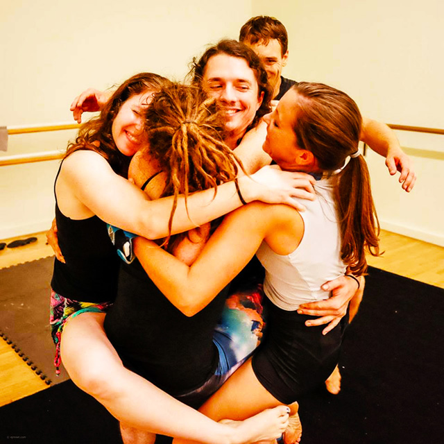 Brittany-Taylor-in-a-group-hug-with-acro-enthusiasts